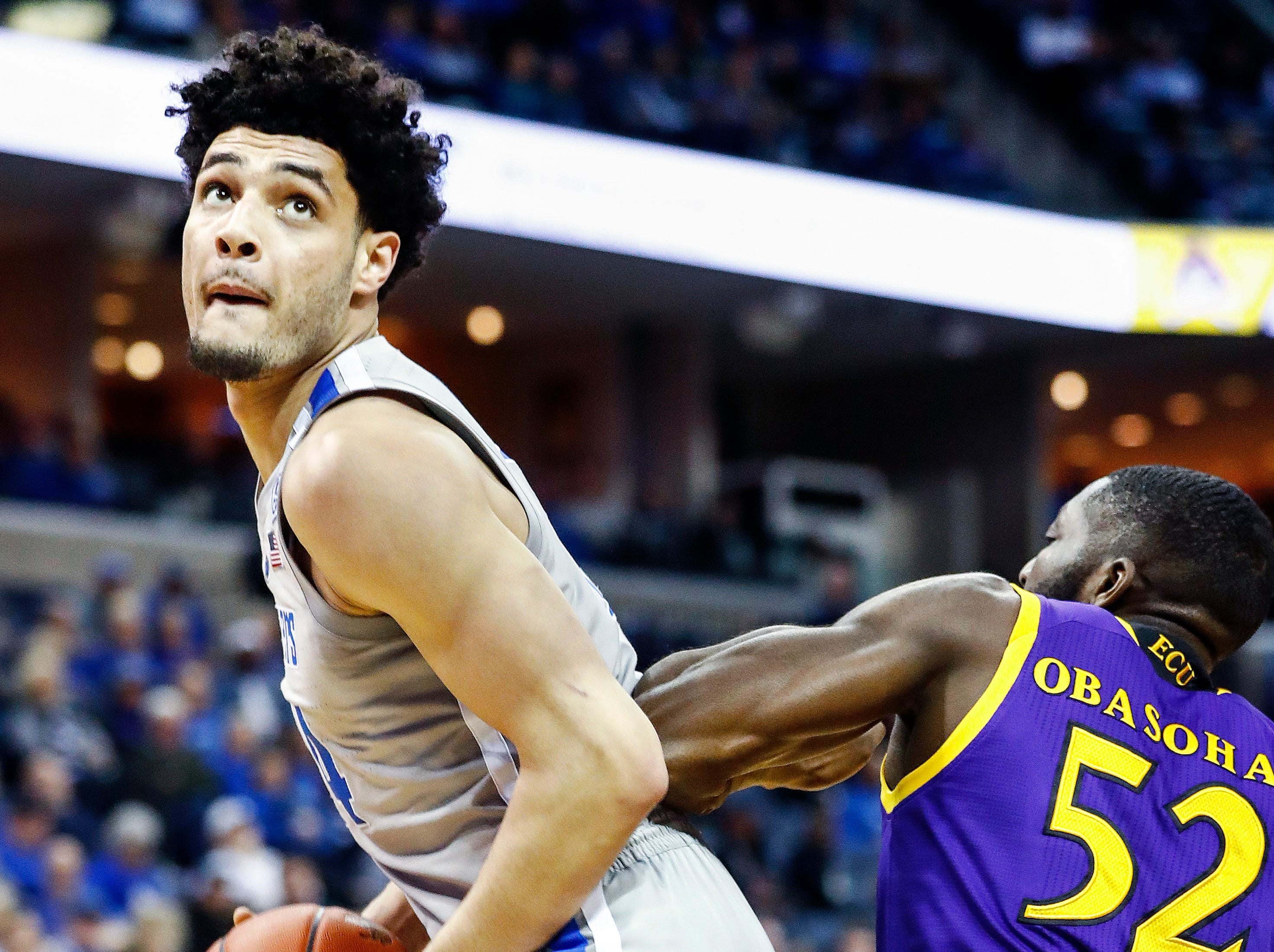 Memphis forward Isaiah Maurice (left) drives the lane against ECU defender Justice Obasohan (right) during action at the FedExForum, Thursday, January 10, 2019.
