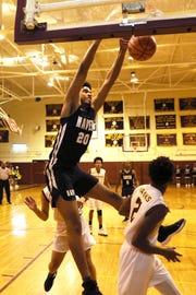 Whitehaven's Jordan Wilmore dunks the ball over Oakhaven's Quintell Blackmon during their game at Oakhaven High School on Thursday, Jan. 10, 2019.