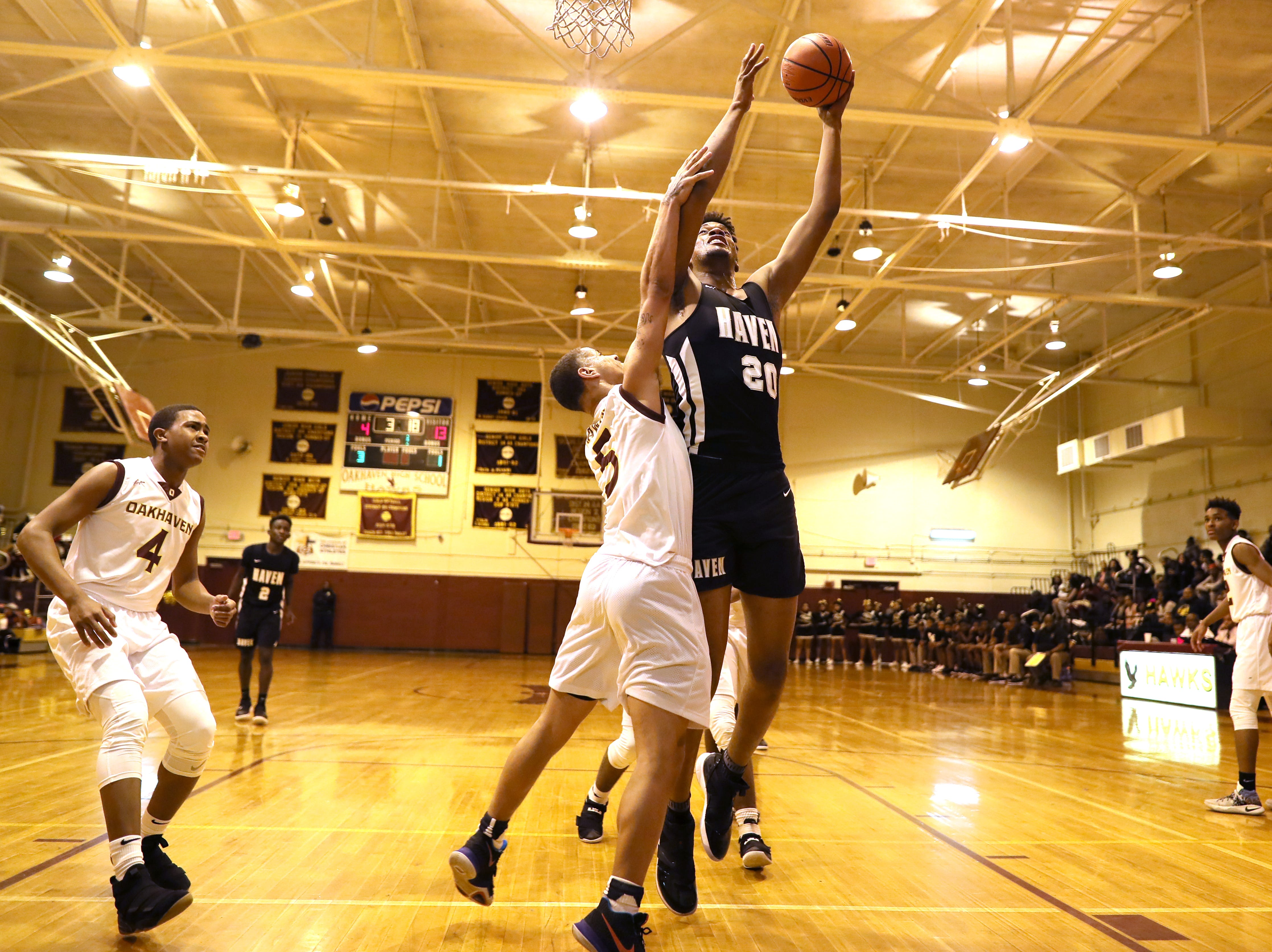 Whitehaven's Jordan Wilmore shoots the ball over Oakhaven's Cameron Howard during their game at Oakhaven High School on Thursday, Jan. 10, 2019.
