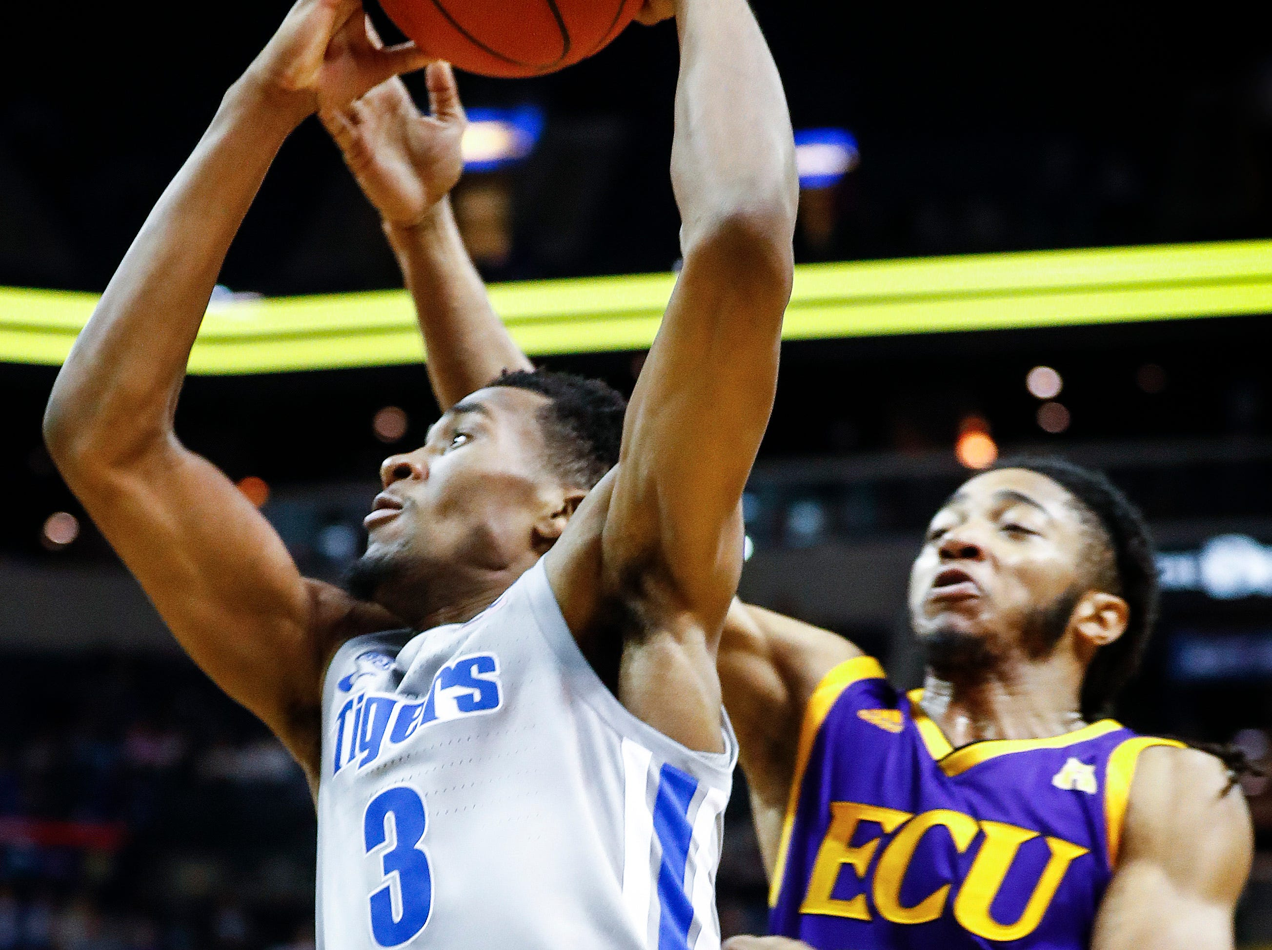 Memphis guard Jeremiah Martin (left) drives to the basket against ECU defender Shawn Williams (right) during action at the FedExForum, Thursday, January 10, 2019.