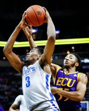 Memphis guard Jeremiah Martin (left) drives to the basket against ECU defender Shawn Williams.