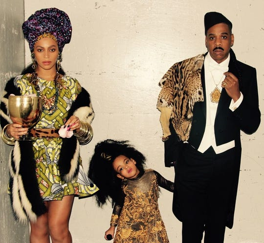 "Pop royalty as fictional royalty: Beyonce and Jay-Z (with their daughter, Blue Ivy) in their 2015 ""Coming to America"" Halloween costumes."