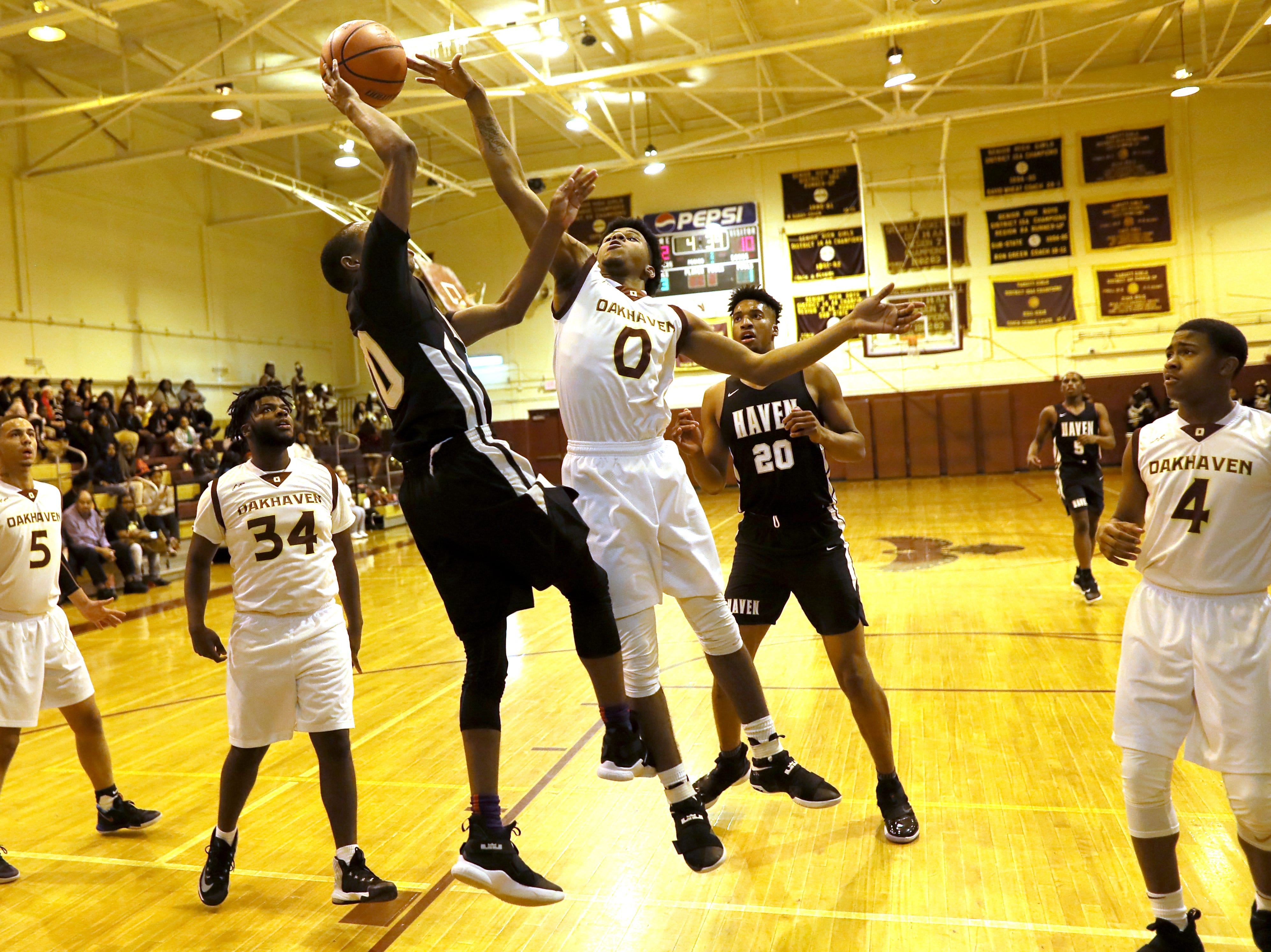 Whitehaven's Antnarn Smith is blocked on a shot attempt by Oakhaven's Rod Brown during their game at Oakhaven High School on Thursday, Jan. 10, 2019.