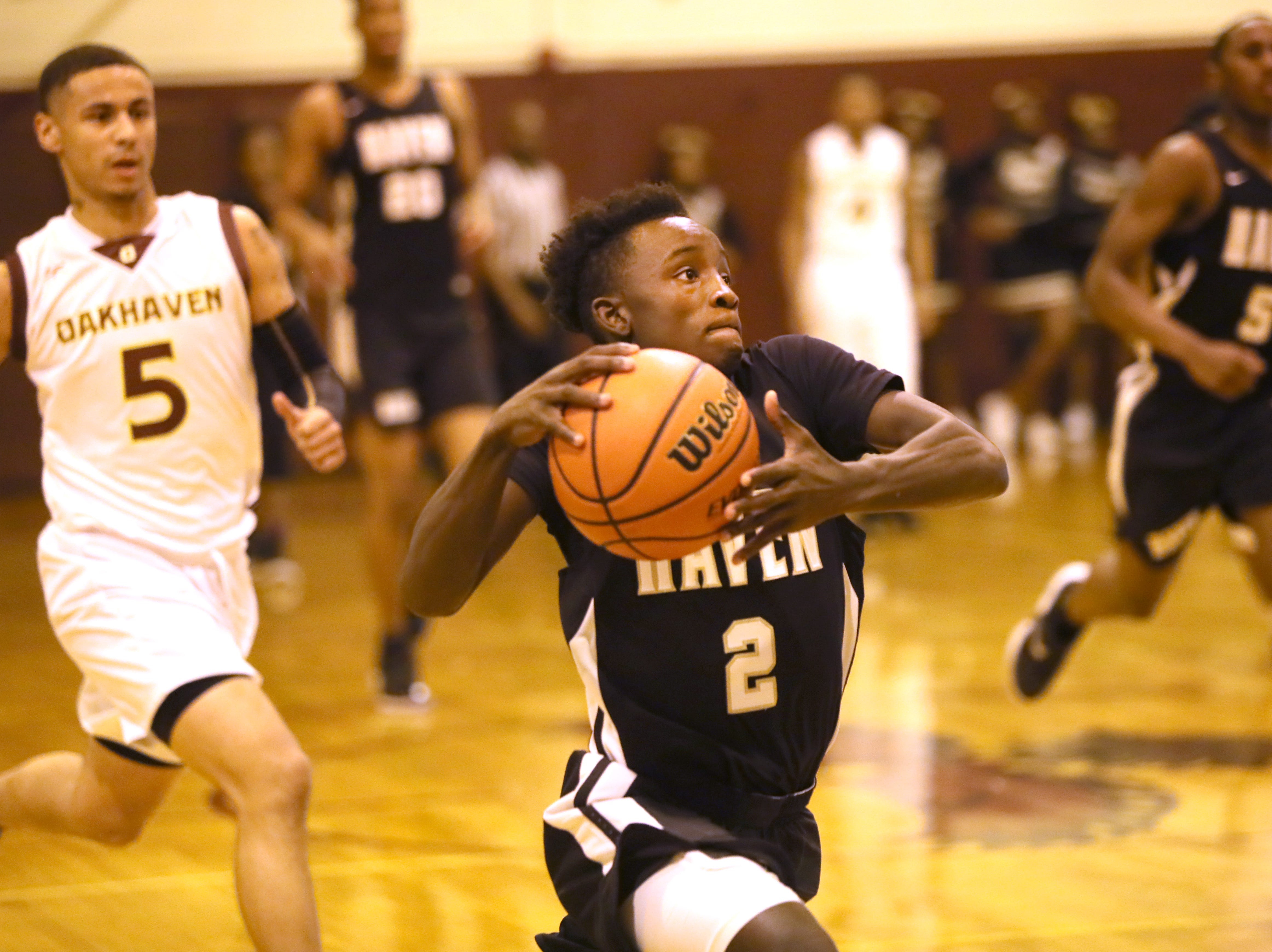 Whitehaven's Kavion McClain drives to the hoop during their game at Oakhaven High School on Thursday, Jan. 10, 2019.