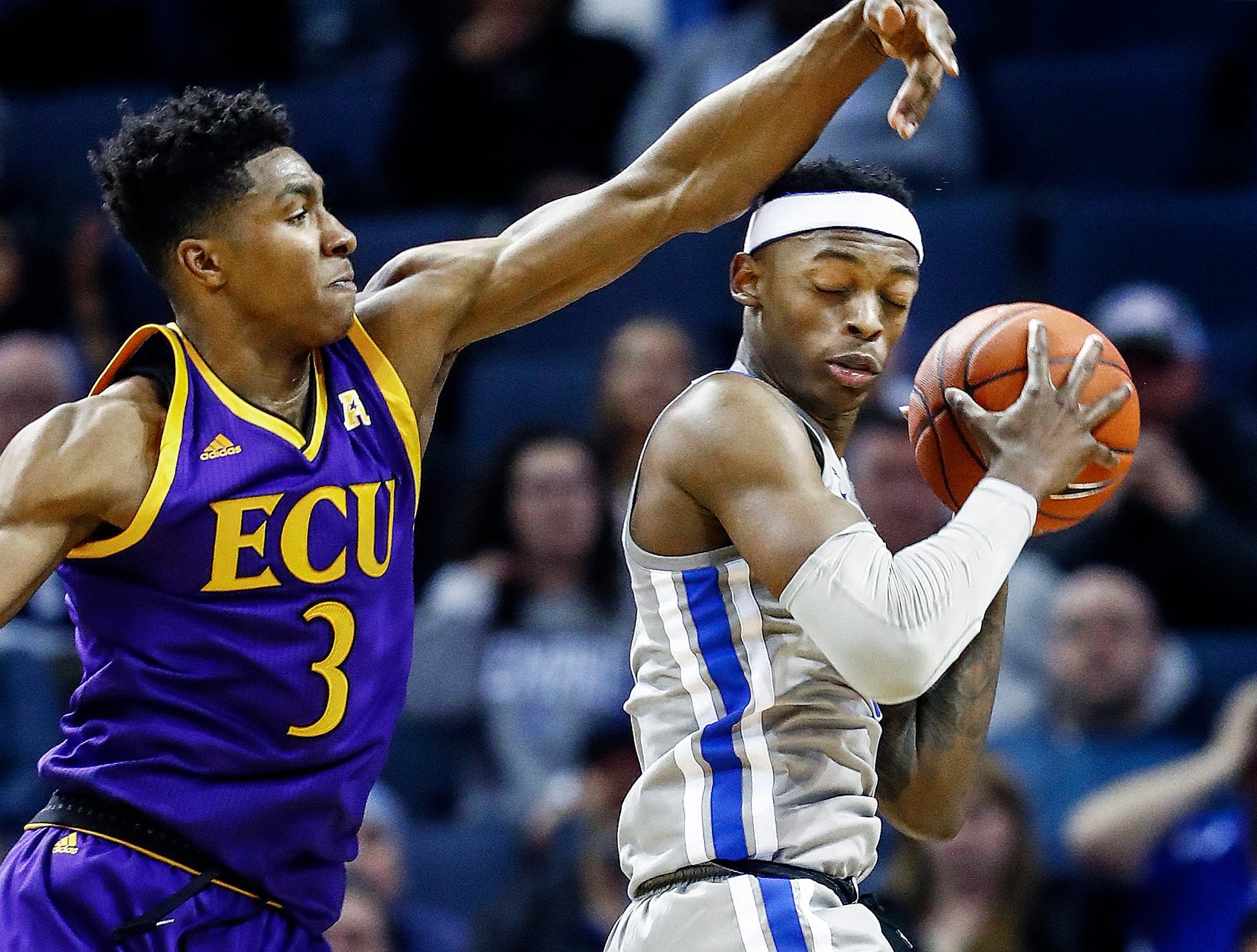 Memphis defender Kyvon Davenport (right) grabs a rebound in front of ECU forward Seth LeDay (left) during action at the FedExForum, Thursday, January 10, 2019.