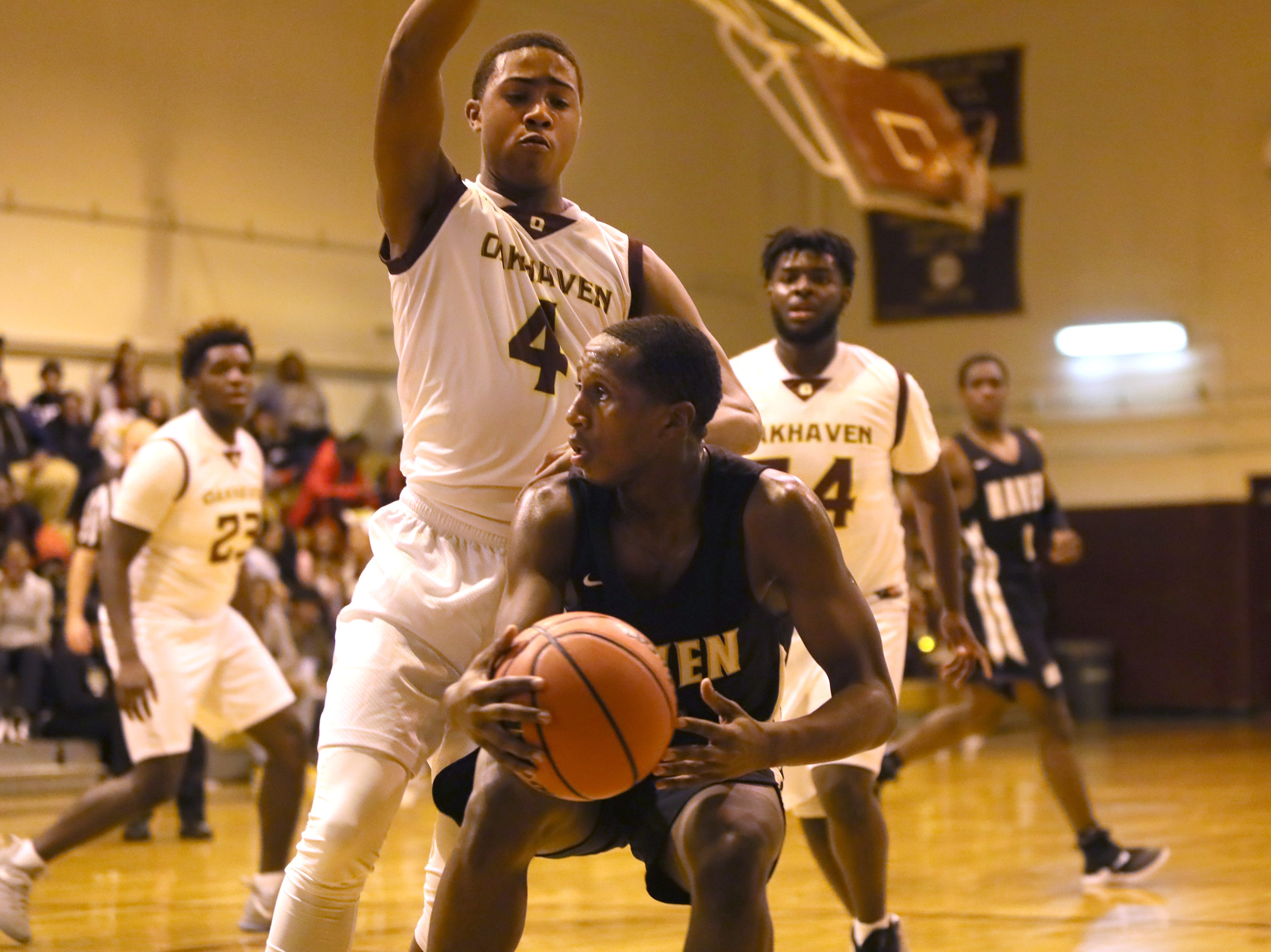 Oakhaven's Terrance Jackson defends Whitehaven's Antnarn Smith during their game at Oakhaven High School on Thursday, Jan. 10, 2019.
