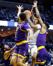 Memphis guard Antwann Jones (middle) is fouled while driving to the basket against the ECU defense during action at the FedExForum, Thursday, January 10, 2019.