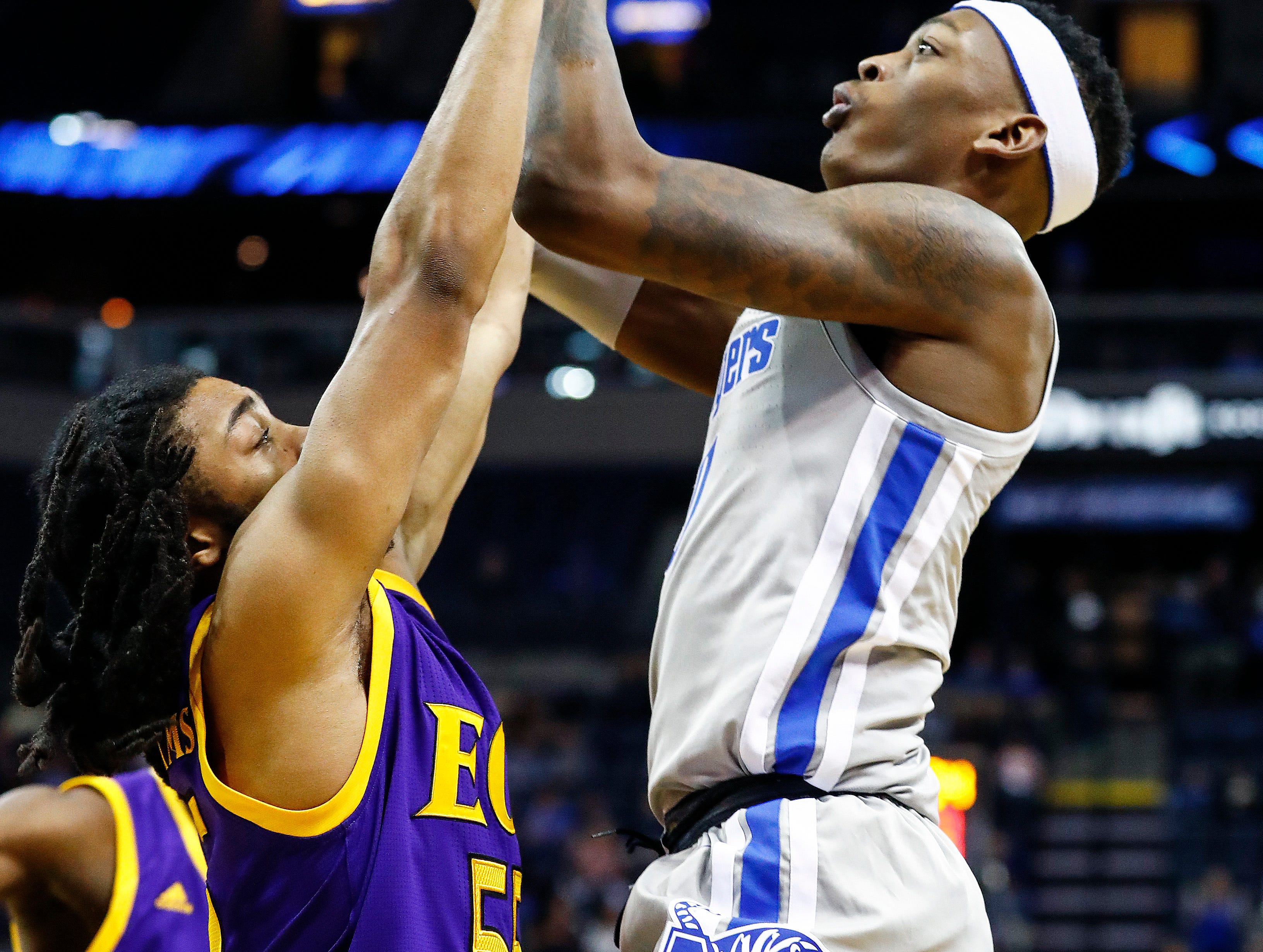 Memphis forward Kyvon Davenport (right) puts up a shot over ECU defender Shawn Williams (left) during action at the FedExForum, Thursday, January 10, 2019.