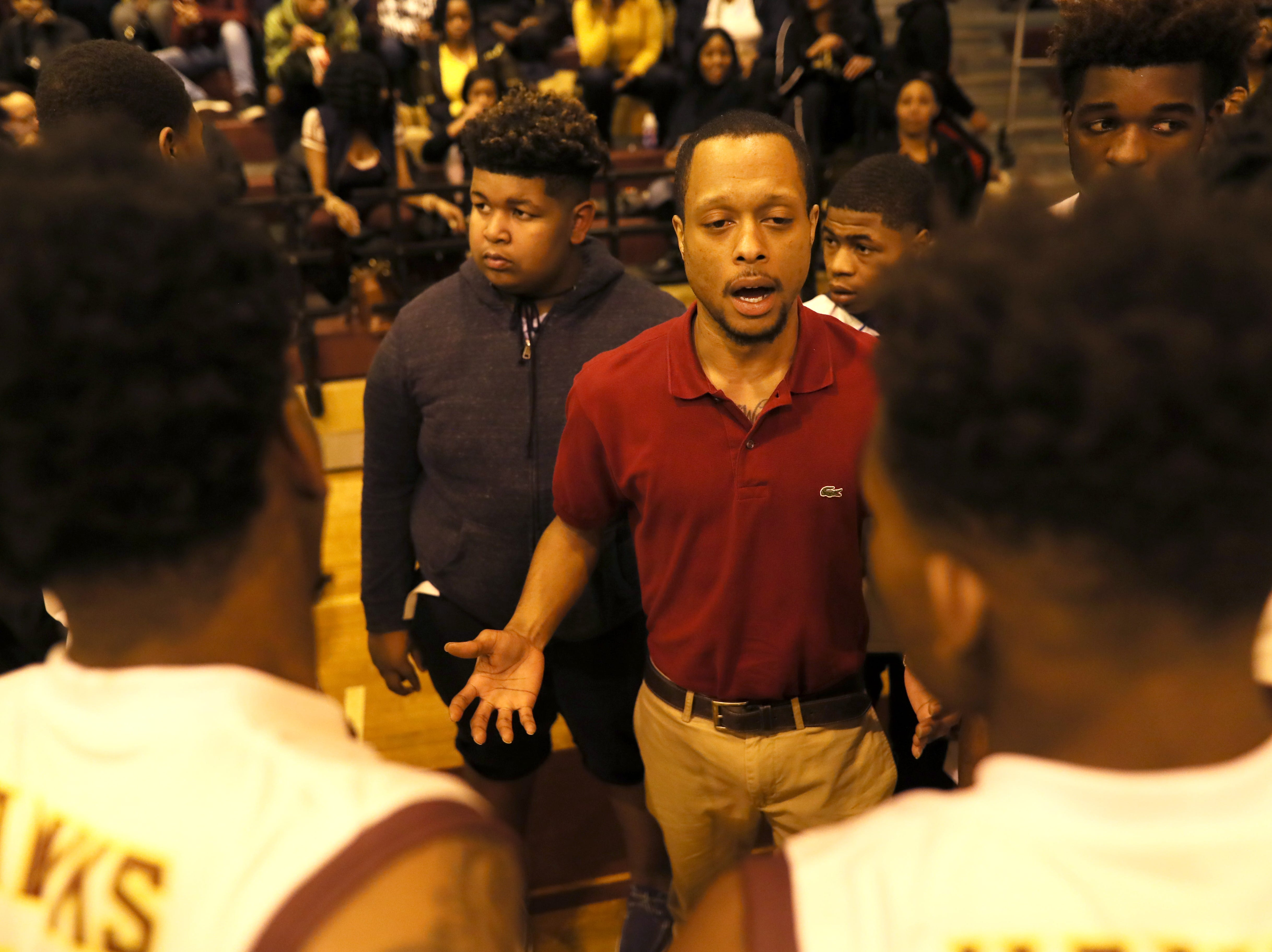 Oakhaven Head Coach Lewis Myers talks to his team during a timeout in their game against Whitehaven at Oakhaven High School on Thursday, Jan. 10, 2019.