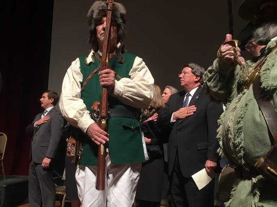 Costumed members of the National Society of Sons of the American Revolution, including John Clines, at right, flank Mark Norris during a ceremony. The ceremony at The Cannon Center on January 11, 2019 marked Norris' public entry into the role of federal judge, though he had already taken the oath of office in a previous private ceremony. At left, not shown, The Peacemakers, a musical group from the Memphis Police Department, was singing the national anthem.
