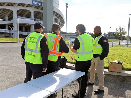 A flight crew conducts a drone mission at the Liberty Bowl in Memphis, part of the Memphis International Airport's drone program.