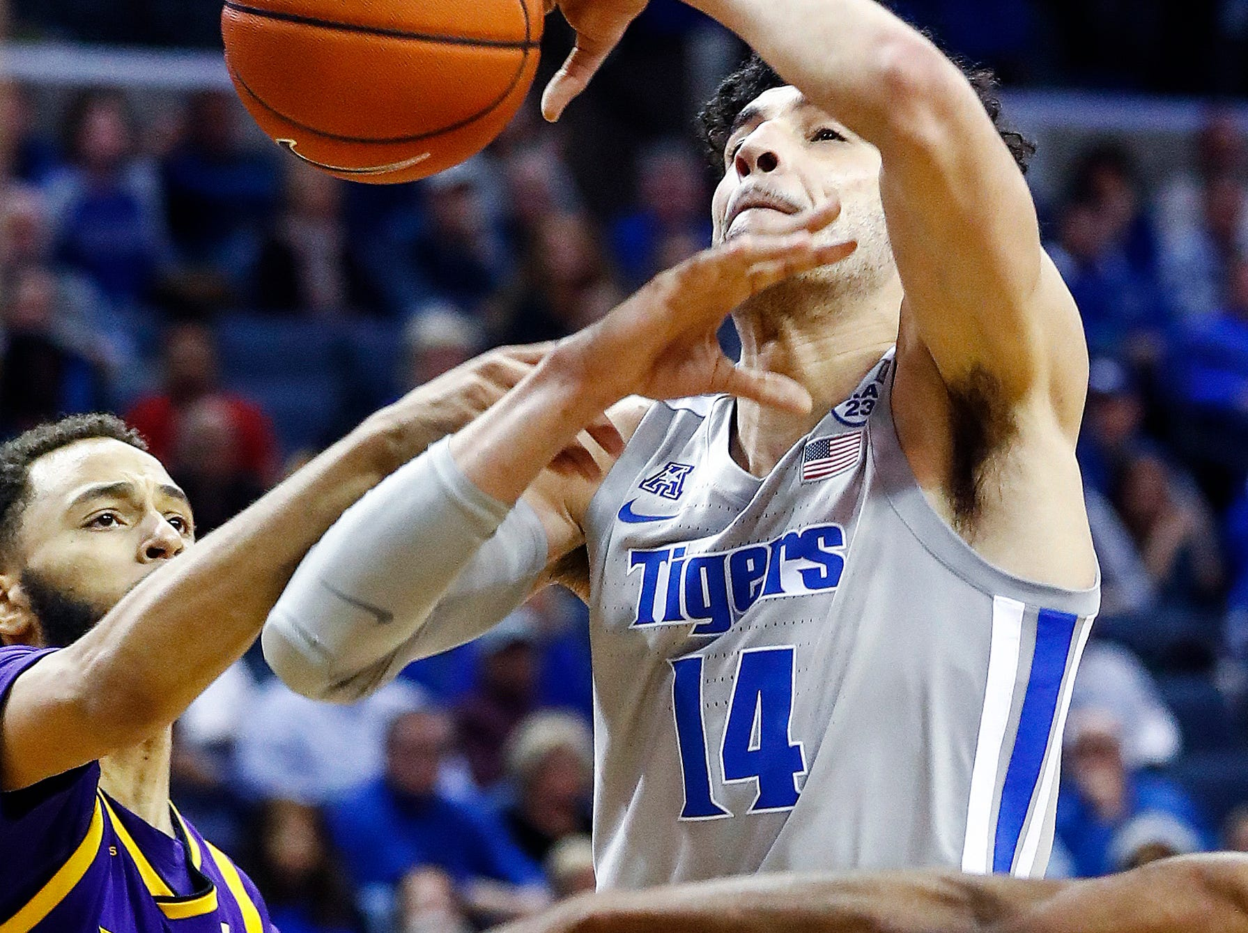 Memphis forward Isaiah Maurice (right) is fouled while driving the lane against the ECU defense during action at the FedExForum, Thursday, January 10, 2019.