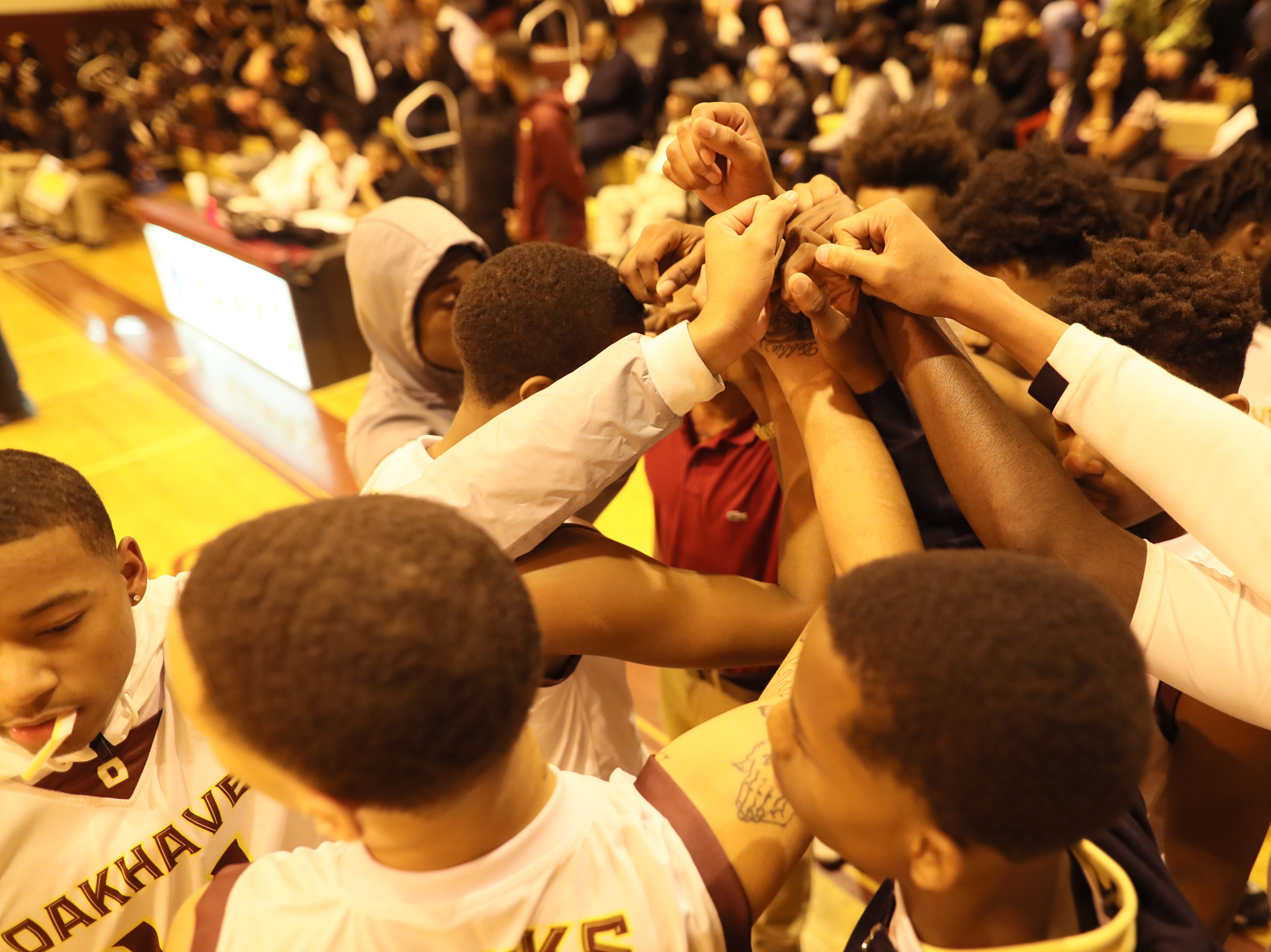 Oakhaven players huddle up before their game against Whitehaven on Thursday, Jan. 10, 2019.