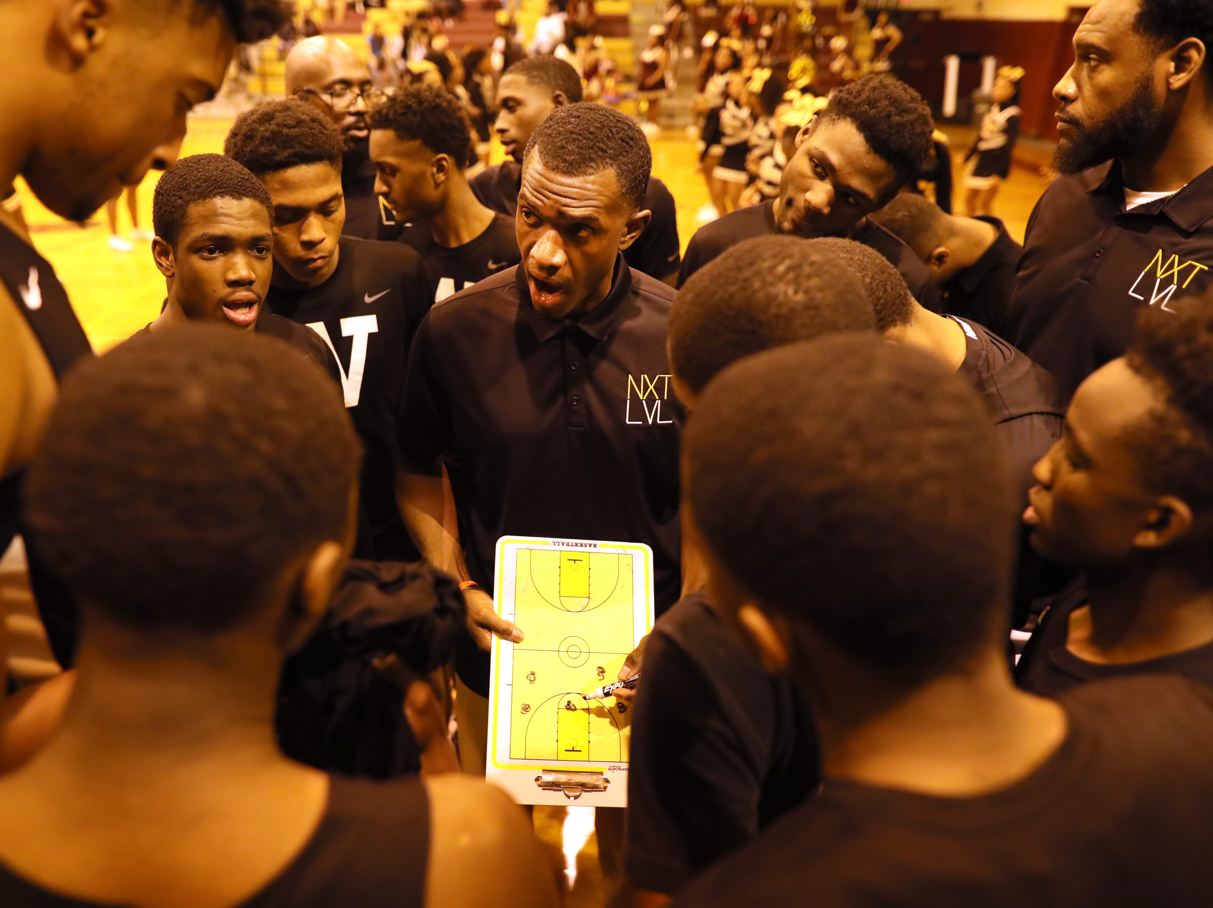 Whitehaven Head Coach Faragi Phillips talks to his team before their game at Oakhaven High School on Thursday, Jan. 10, 2019.