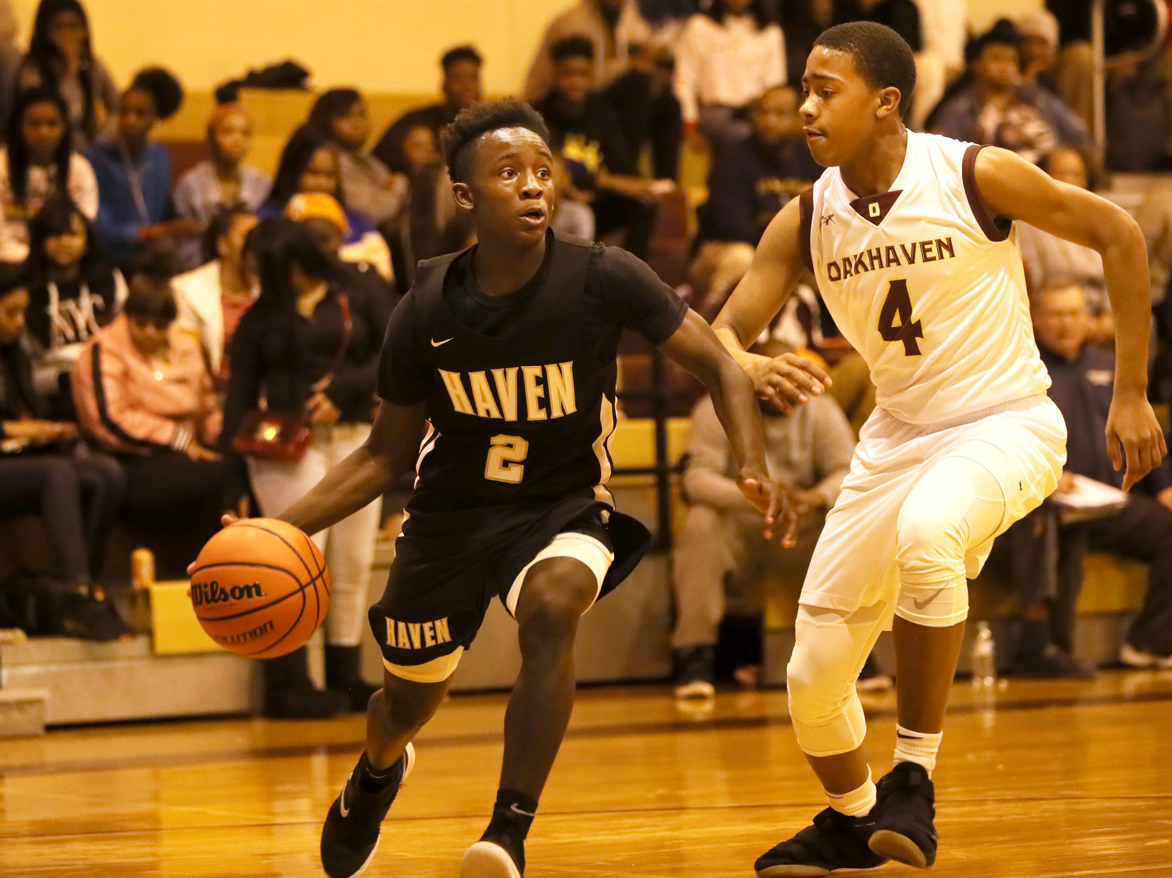 Whitehaven's Kavion McClain drives the baseline as Oakhaven's Terrance Jackson defends during their game at Oakhaven High School on Thursday, Jan. 10, 2019.