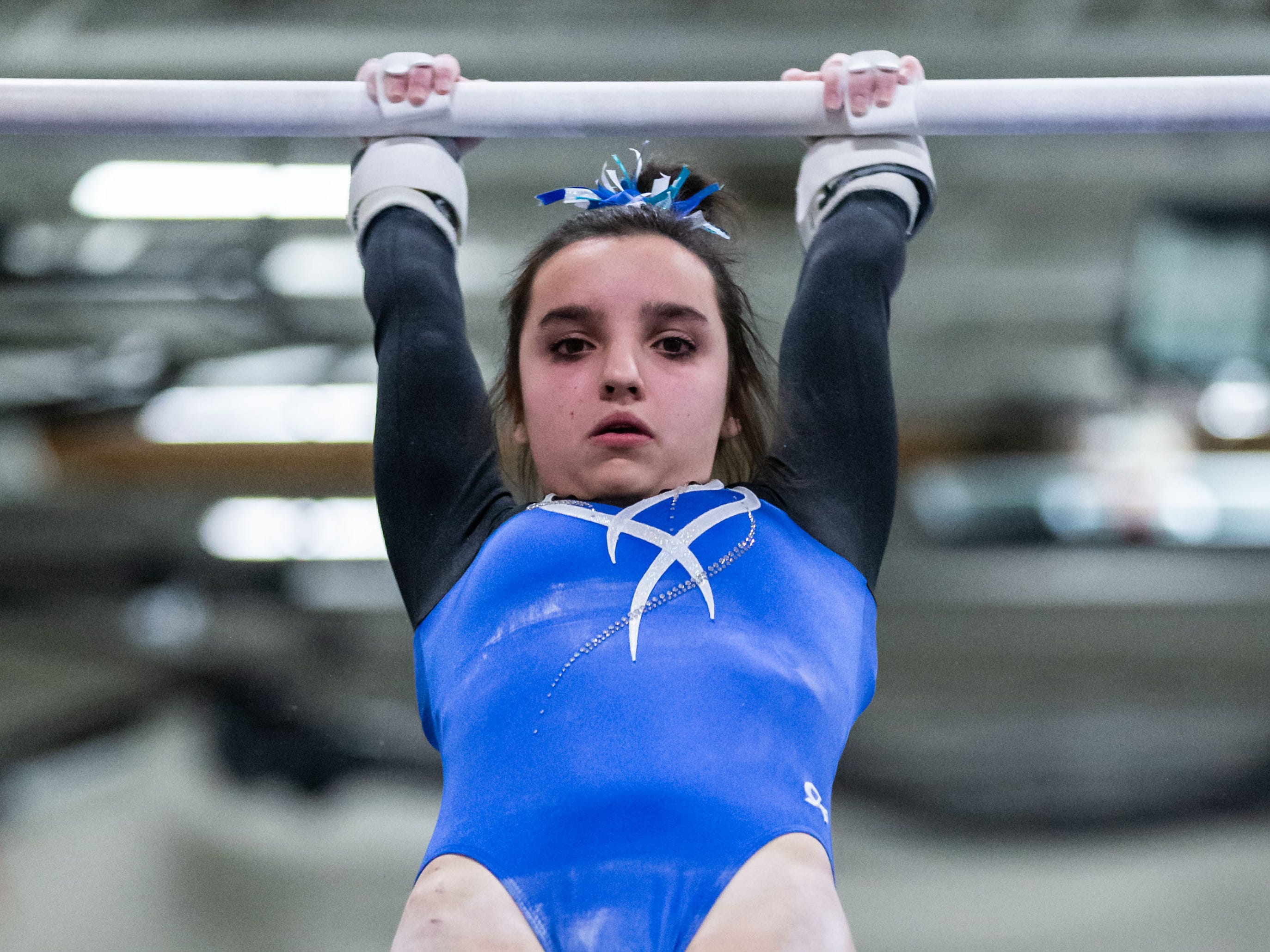 Nicolet gymnast Ava Sahin competes on the bars during the meet at home against Whitefish Bay on Thursday, Jan. 3, 2019.