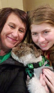Jayme Closs poses with her aunt, Jennifer Smith, and her dog, with whom she was reunited Friday. The photo was posted on the Healing for Jayme Closs Facebook page.