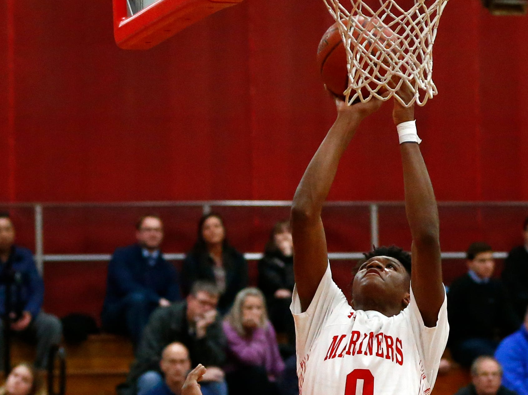 St. Francis' Isaiah Duncan fires for two points over St. Thomas More defenders at St. Francis on Jan. 10.