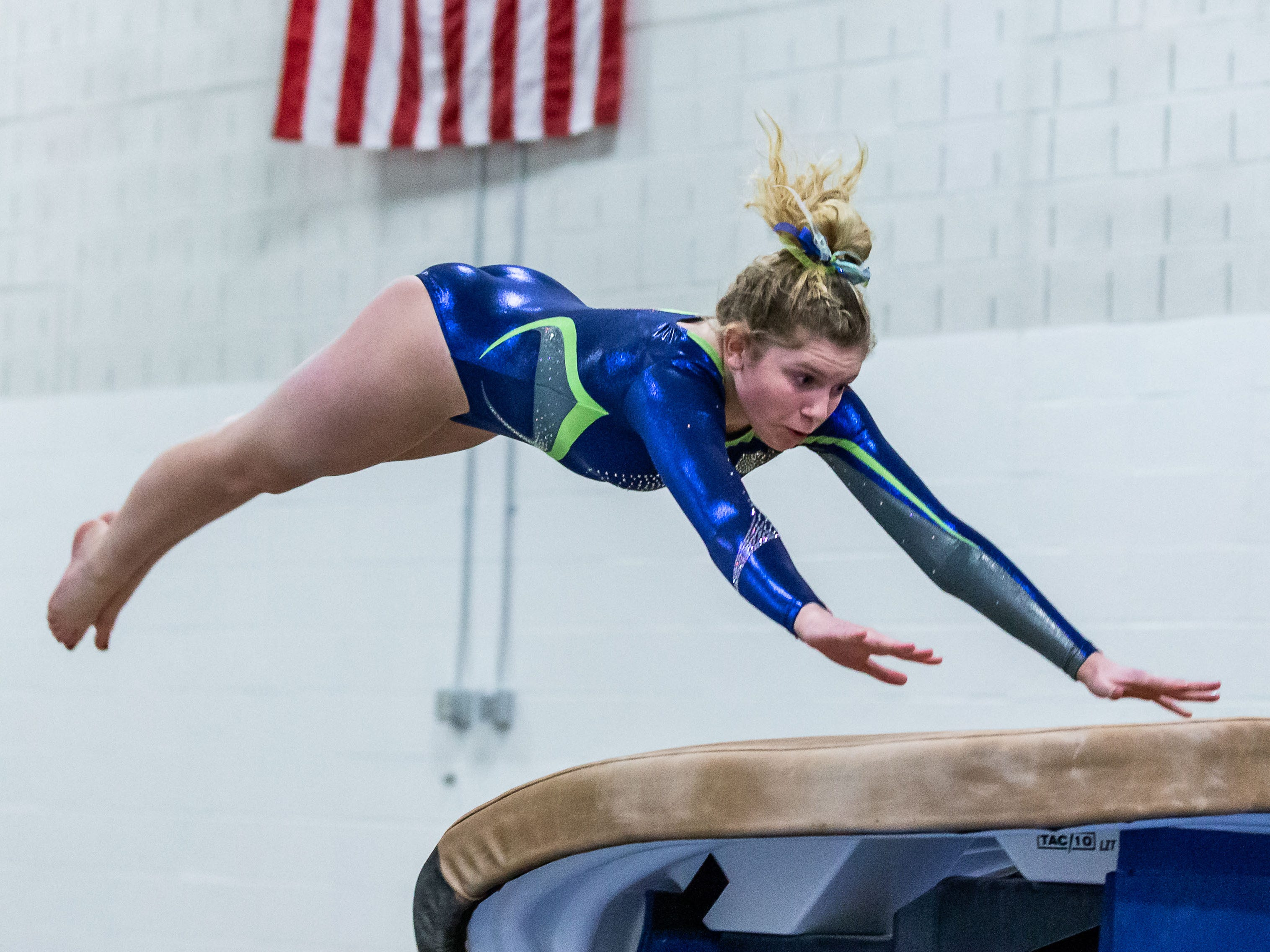 Whitefish Bay gymnast Erin Timms competes on the vault during the meet at Nicolet on Thursday, Jan. 3, 2019.