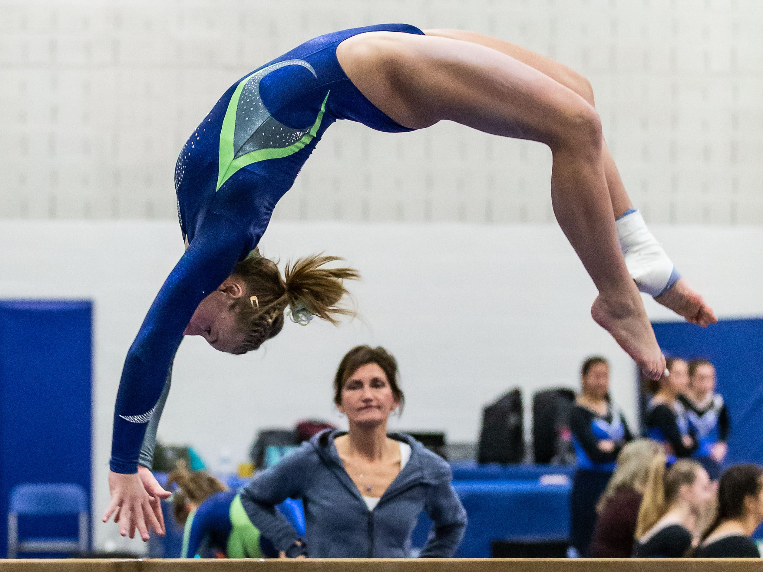 Whitefish Bay gymnast Addie Gallun competes on the beam during the meet at Nicolet on Thursday, Jan. 3, 2019. Gallun won the event with a score of 9.30.
