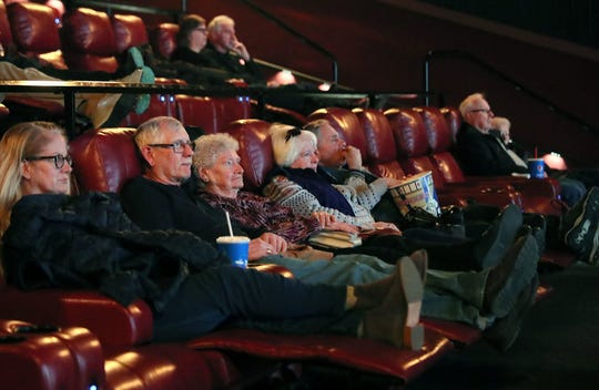 Movie-goers enjoy a matinee Thursday at the Marcus Majestic theater, which now features reclining seats.