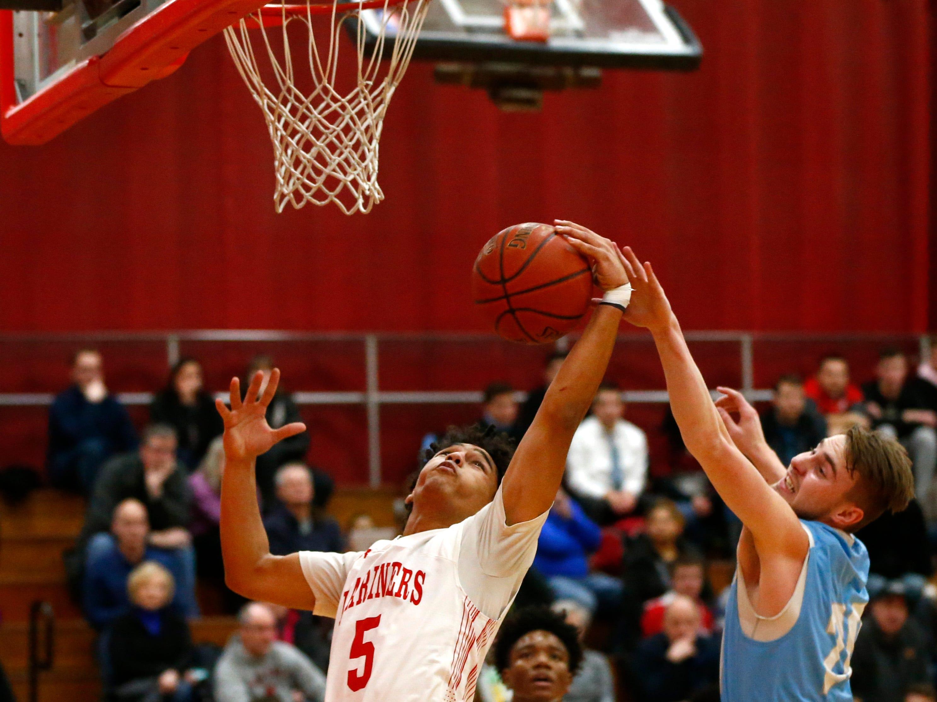St. Francis' Jaden Mack rebounds from St. Thomas More's Noah Glembin at St. Francis on Jan. 10.