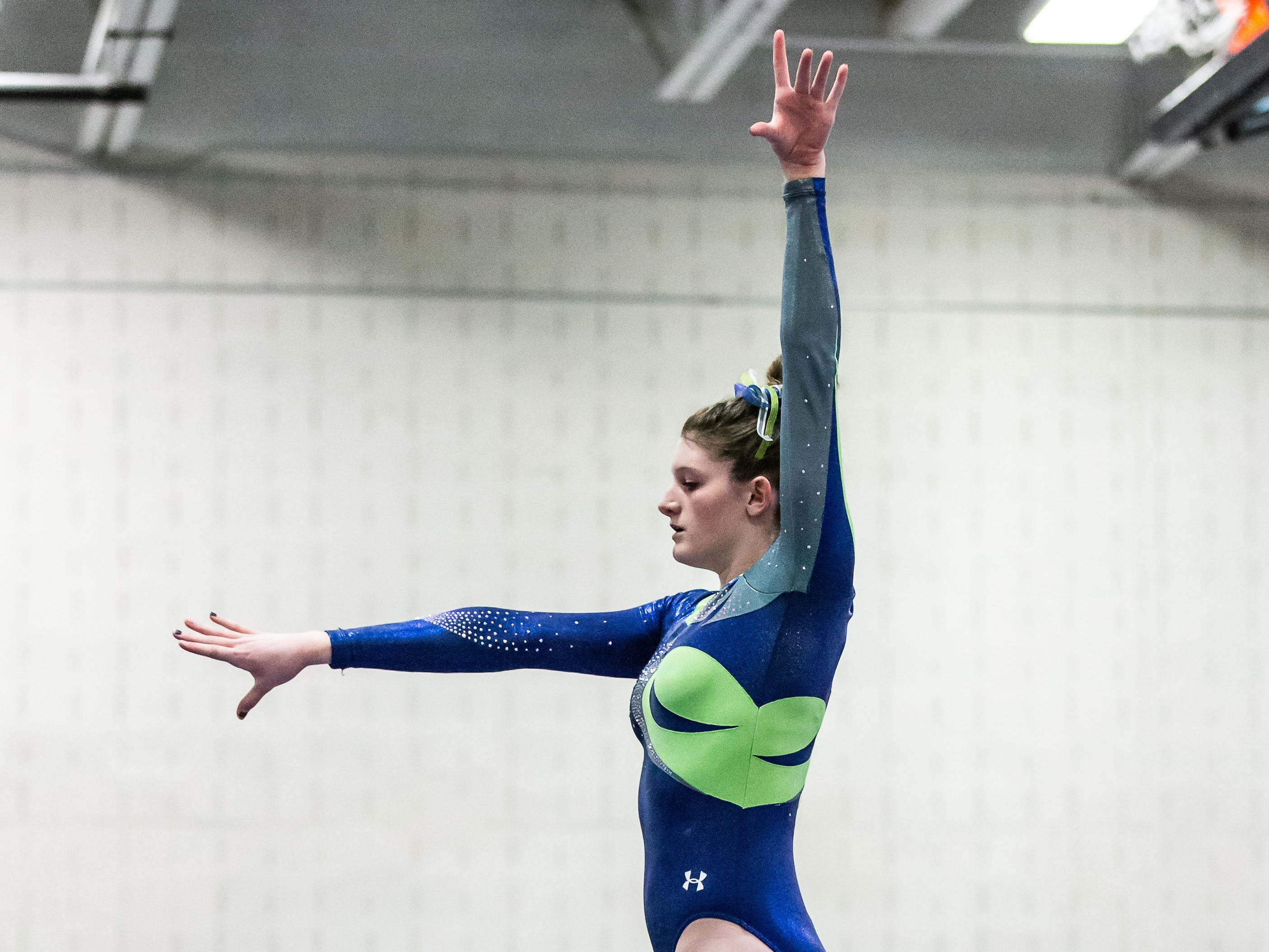 Whitefish Bay gymnast Emma Fox competes on the beam during the meet at Nicolet on Thursday, Jan. 3, 2019. Fox placed second in the event with a score of 8.85.