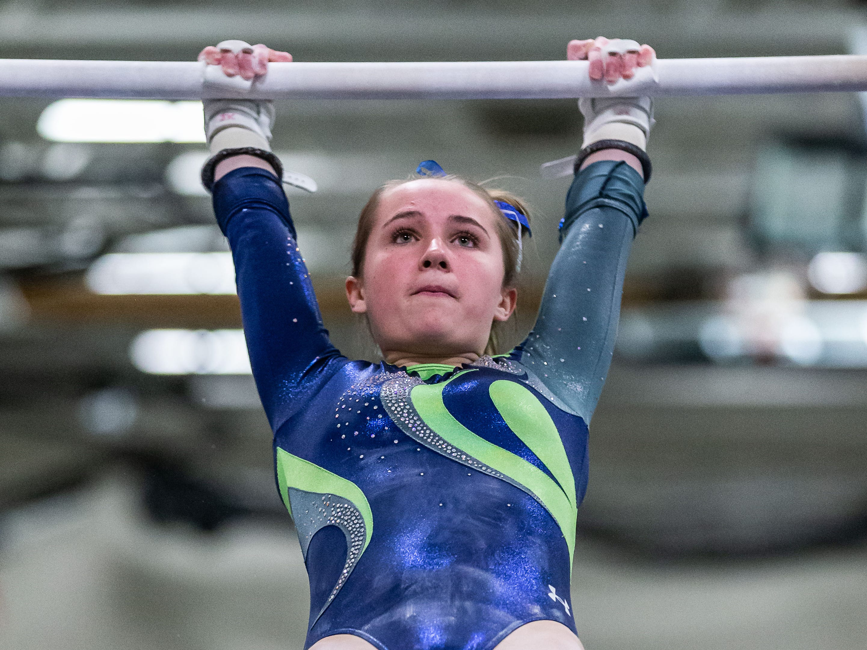 Whitefish Bay gymnast Sarah Kirchner competes on the bars during the meet at Nicolet on Thursday, Jan. 3, 2019.