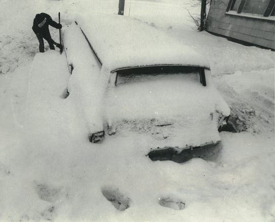 Joseph Jones tries to dig out his car on West Hampton Avenue on Jan. 1, 1979, after a New Year's Eve blizzard dumped more than 13 inches of snow on Milwaukee. This photo was published in the Jan. 2, 1979, Milwaukee Sentinel.