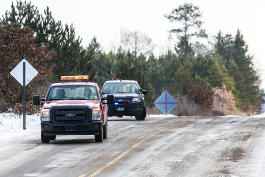 Law enforcement vehicles park on County Road Y near Eau Claire Acres Circle where Jayme Closs was kept.