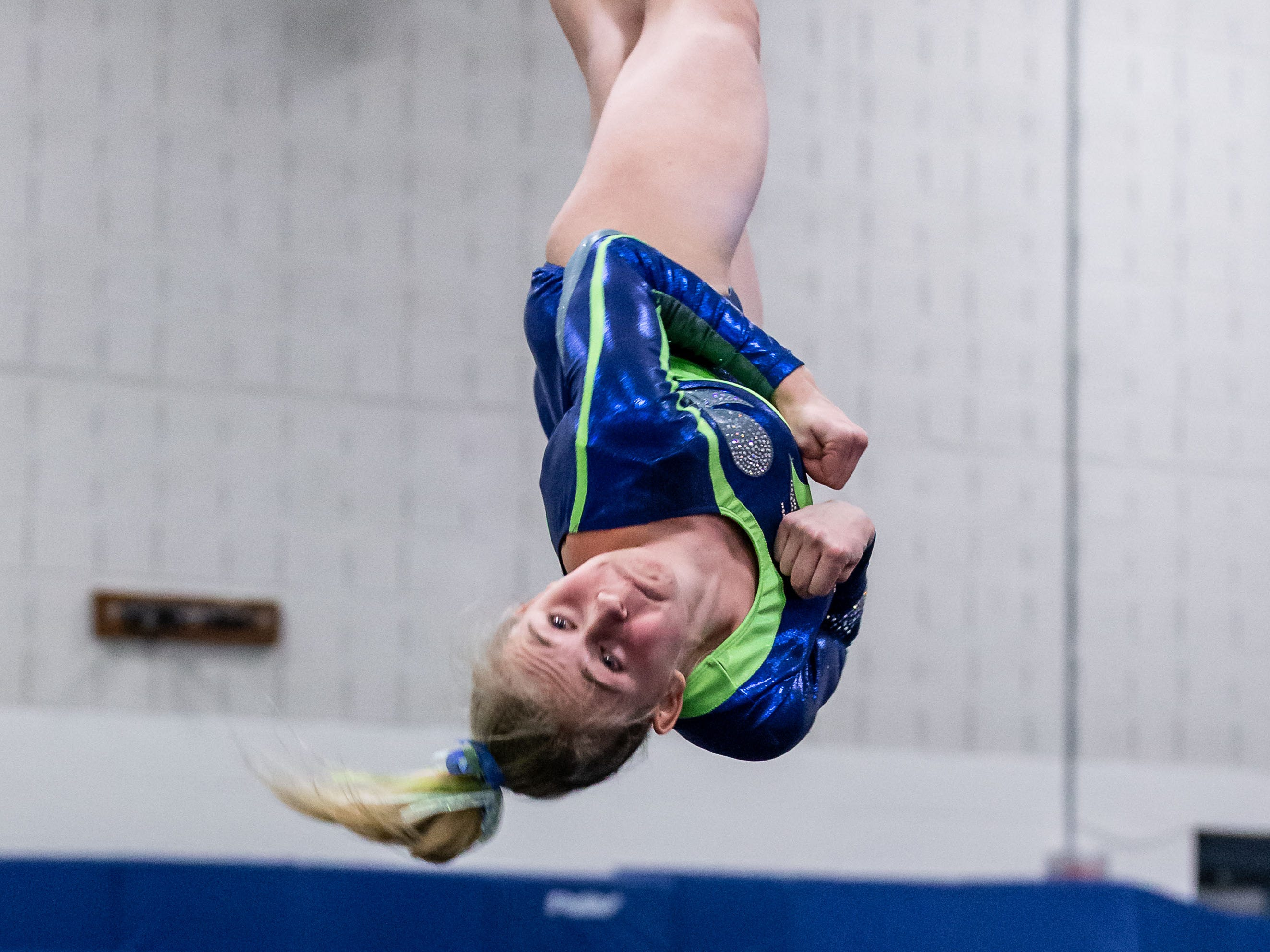 Whitefish Bay gymnast Anneh Britz competes on the floor during the meet at Nicolet on Thursday, Jan. 3, 2019.