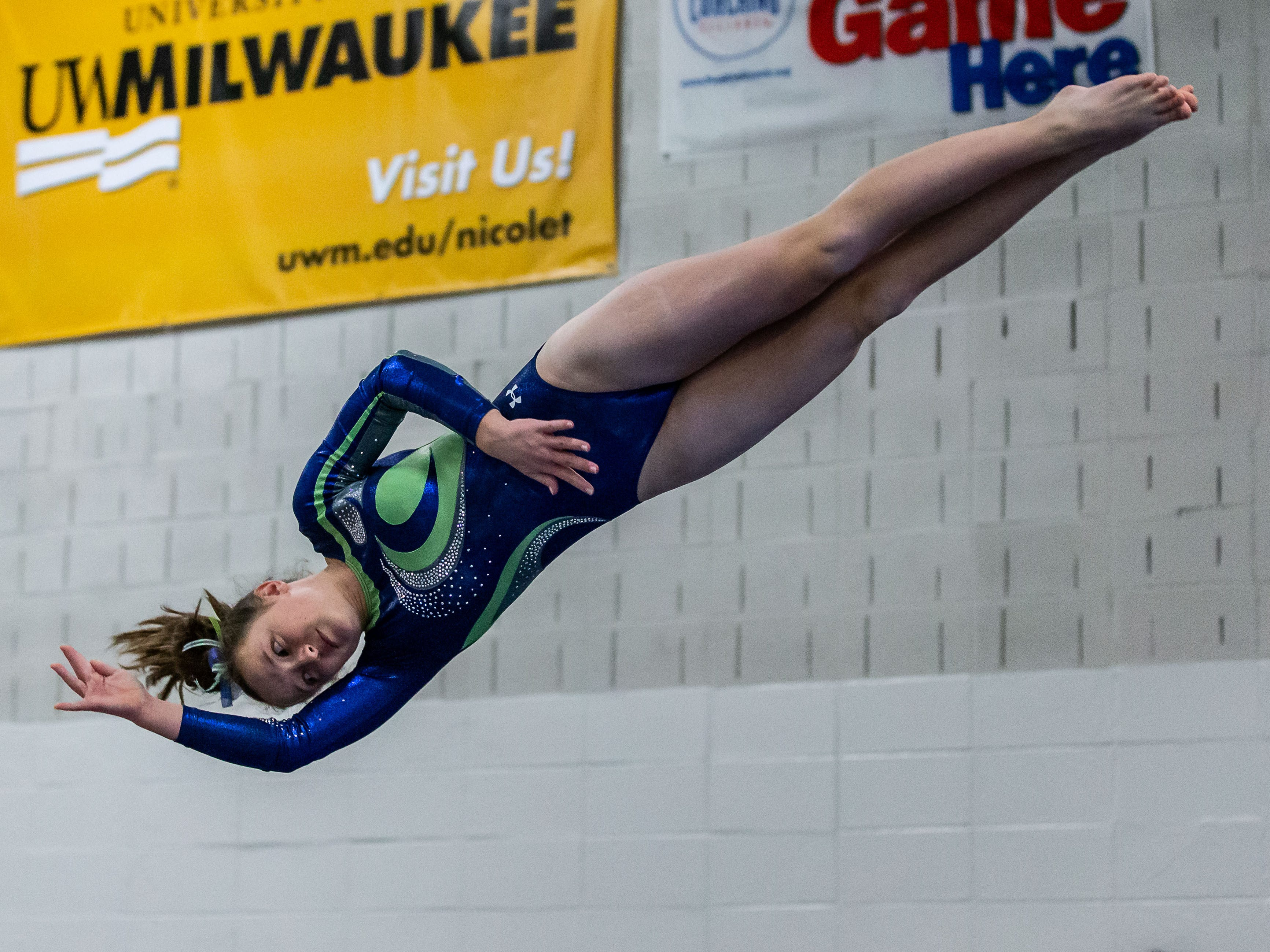Whitefish Bay gymnast Madi Kogler launches off the vault during the meet at Nicolet on Thursday, Jan. 3, 2019.