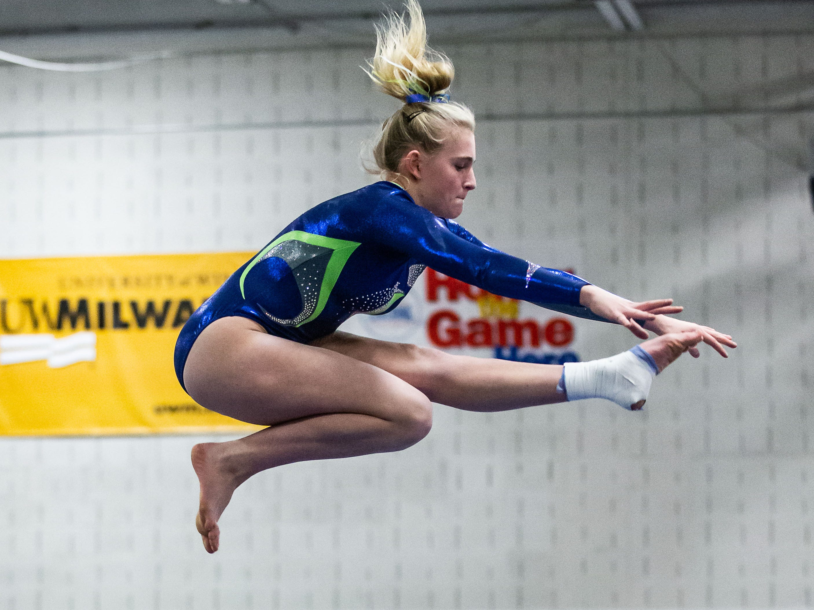 Whitefish Bay gymnast Anneh Britz competes on the beam during the meet at Nicolet on Thursday, Jan. 3, 2019.