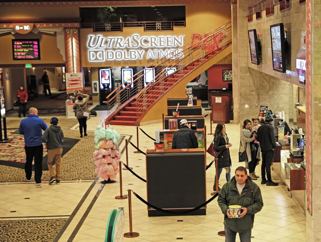 People purchase food and snacks Thursday at the Marcus Majestic theater in Brookfield. Marcus Corp. was the top-performing stock among Wisconsin's major public companies in 2018.