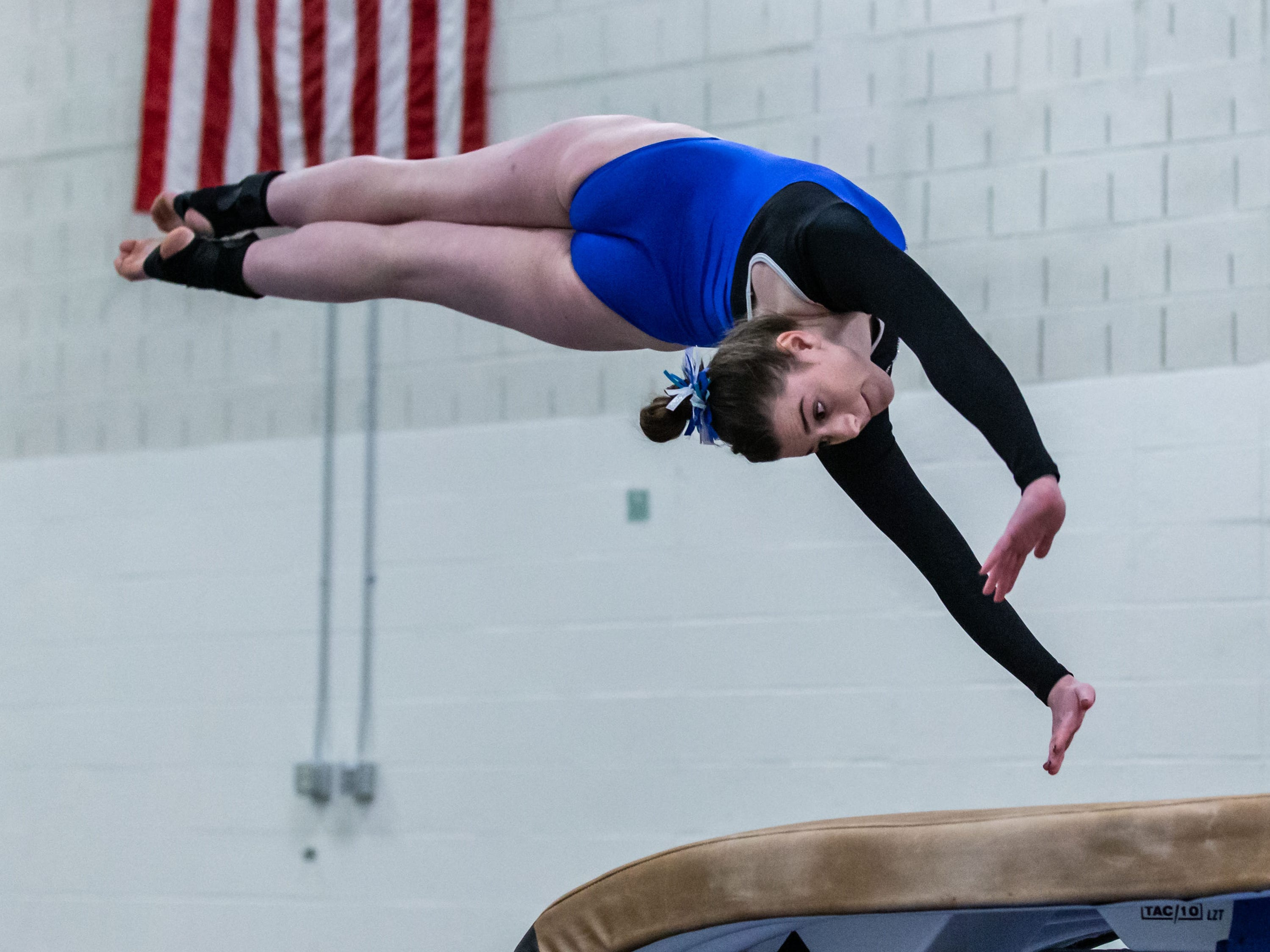 Nicolet gymnast Morgan Schiff competes on the vault during the meet at home against Whitefish Bay on Thursday, Jan. 3, 2019.