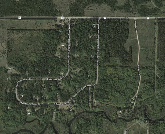 A satellite image from Google Maps shows the wooded area surrounding Eau Claire Acres where Jayme Closs was found.