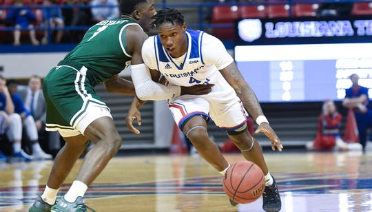 Louisiana Tech junior point guard DaQuan Bracey (4) drives past UAB's Zack Bryant during a Conference USA contest Thursday, Jan. 10, 2019 at the Thomas Assembly Center.