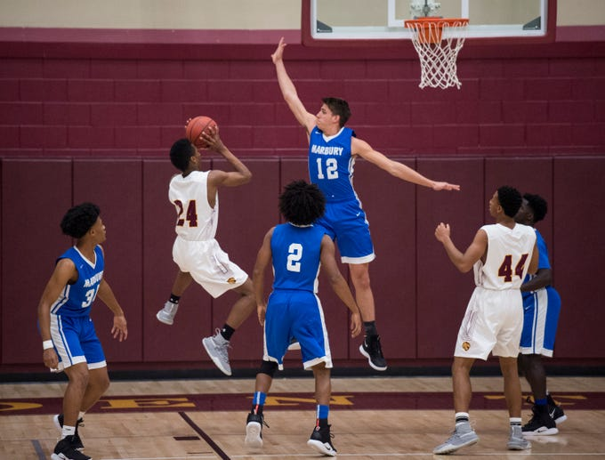 LAMP's Micah Boone (24) takes a floater over Marbury's Samuel Klimek (12) at LAMP high school in Montgomery, Ala., on Thursday, Jan. 10, 2019. LAMP defeated Marbury 85-72.