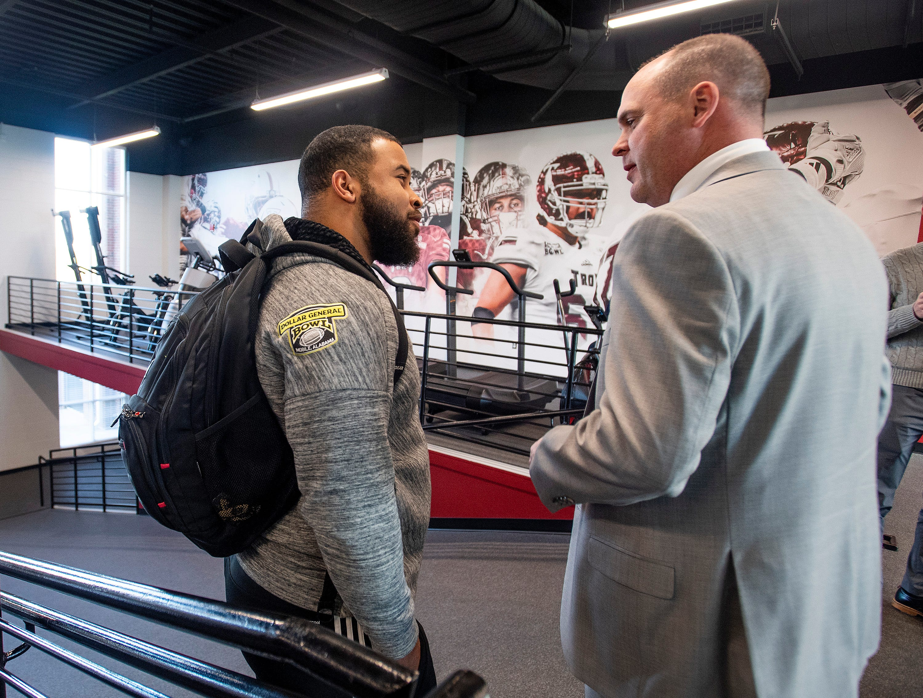 New Troy University Head Football Coach Chip Lindsey talks with Josh Anderson on the Troy campus in Troy, Ala., on Friday January 11, 2019.
