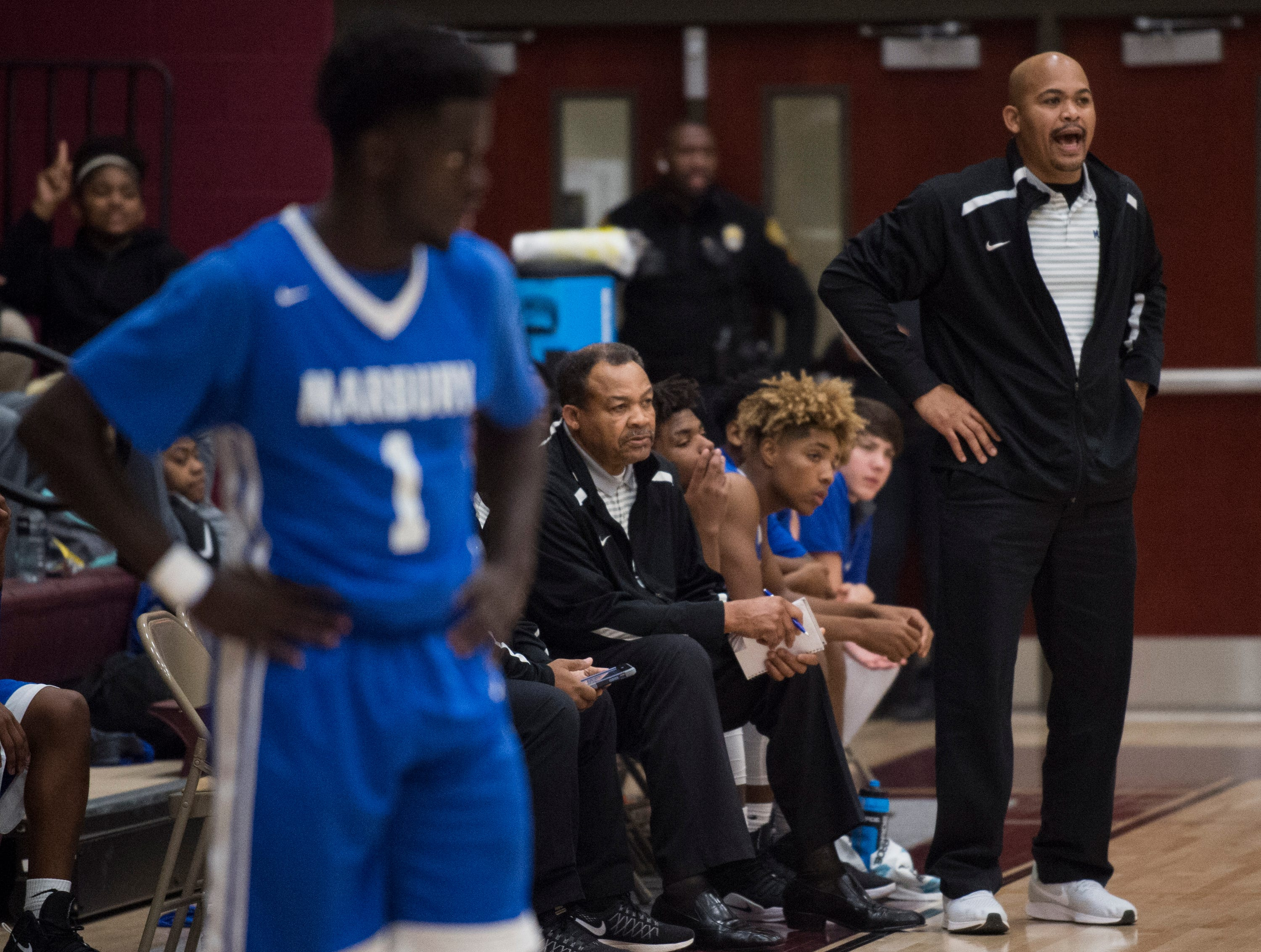 Marbury head coach Reginald Brown yells from the bench at LAMP high school in Montgomery, Ala., on Thursday, Jan. 10, 2019. LAMP defeated Marbury 85-72.