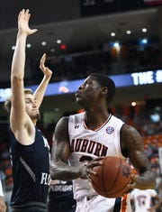 Auburn forward Danjel Purifoy (3) attempts to shoot over North Florida guard Ryan Burkhardt (12) on Saturday, Dec. 29, 2018, in Auburn, Ala.