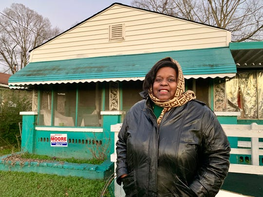 "Keisha Brown, 40, stands outside her home in the the Harriman Park neighborhood in Birmingham, Ala. on Wednesday, Jan. 9, 2019.  Brown's home is within a designated Superfund site in north Birmingham. Residents of the north Birmingham neighborhoods, nestled near industrial coke plants, have expressed frustration about the pollution that has plagued the area for decades. ""We are overlooked,"" Brown said. (AP Photo/Kimberly Chandler)"