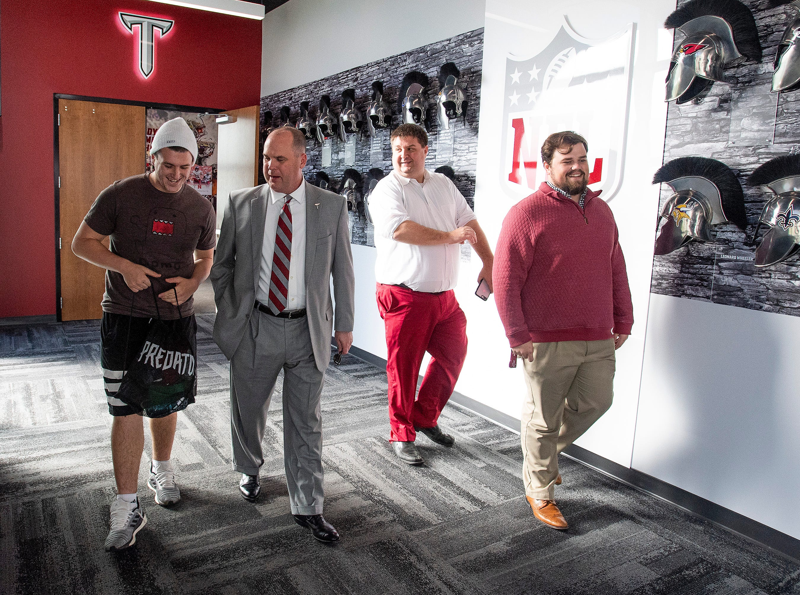 New Troy University Head Football Coach Chip Lindsey talks with Tyler Sumpter on the Troy campus in Troy, Ala., on Friday January 11, 2019.