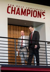 New Troy University Head Football Coach Chip Lindsey talks with Athletic Director Jeremy McClain on the Troy campus in Troy, Ala., on Friday January 11, 2019.