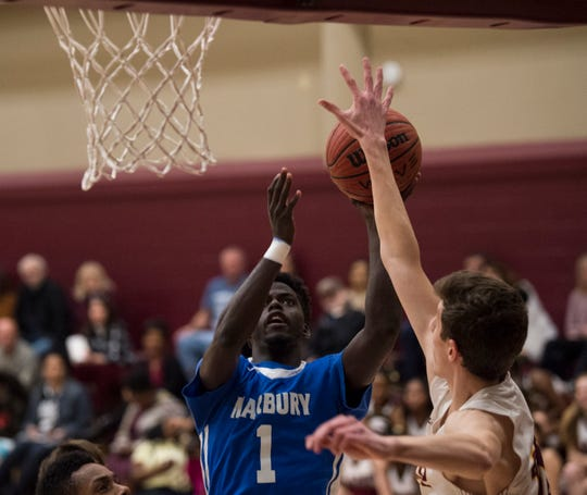 Marbury's Jakhiel Waller (1) goes up for a layup at LAMP high school in Montgomery, Ala., on Thursday, Jan. 10, 2019. LAMP defeated Marbury 85-72.