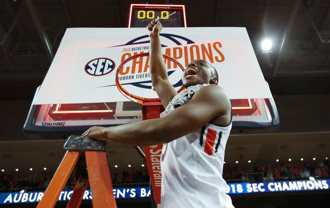 Auburn guard Mustapha Heron celebrates after cutting the net after a game against South Carolina, Saturday, March 3, 2018, in Auburn, Ala.