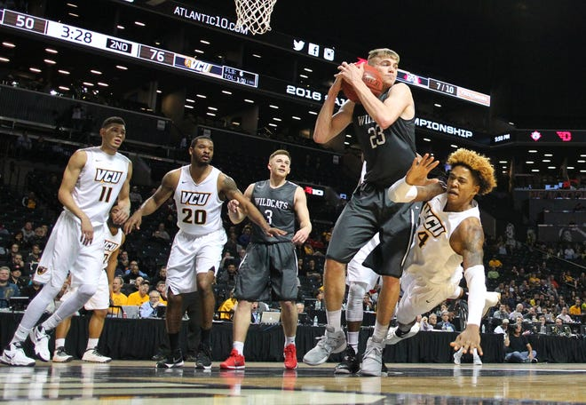Mar 12, 2016; Brooklyn, NY, USA; Davidson Wildcats forward Peyton Aldridge (23) grabs a rebound away from  Virginia Commonwealth Rams forward Justin Tillman (4) during the second half in the semifinals of the Atlantic 10 conference tournament at Barclays Center. Virginia Commonwealth Rams won 76-54. Mandatory Credit: Anthony Gruppuso-USA TODAY Sports