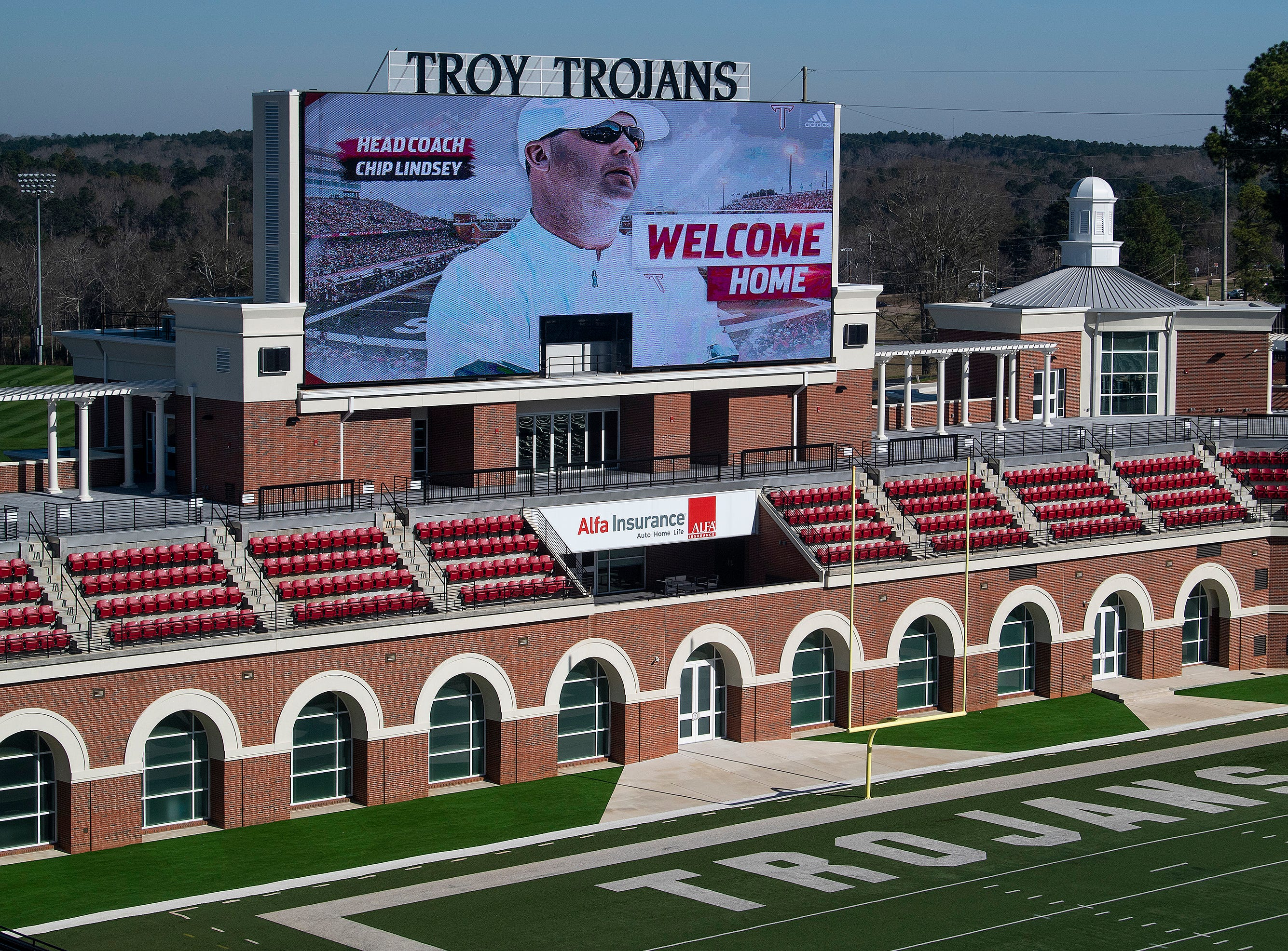 New Troy University Head Football Coach Chip Lindsey is shown on the big screen at the football stadium on the Troy campus in Troy, Ala., on Friday January 11, 2019.