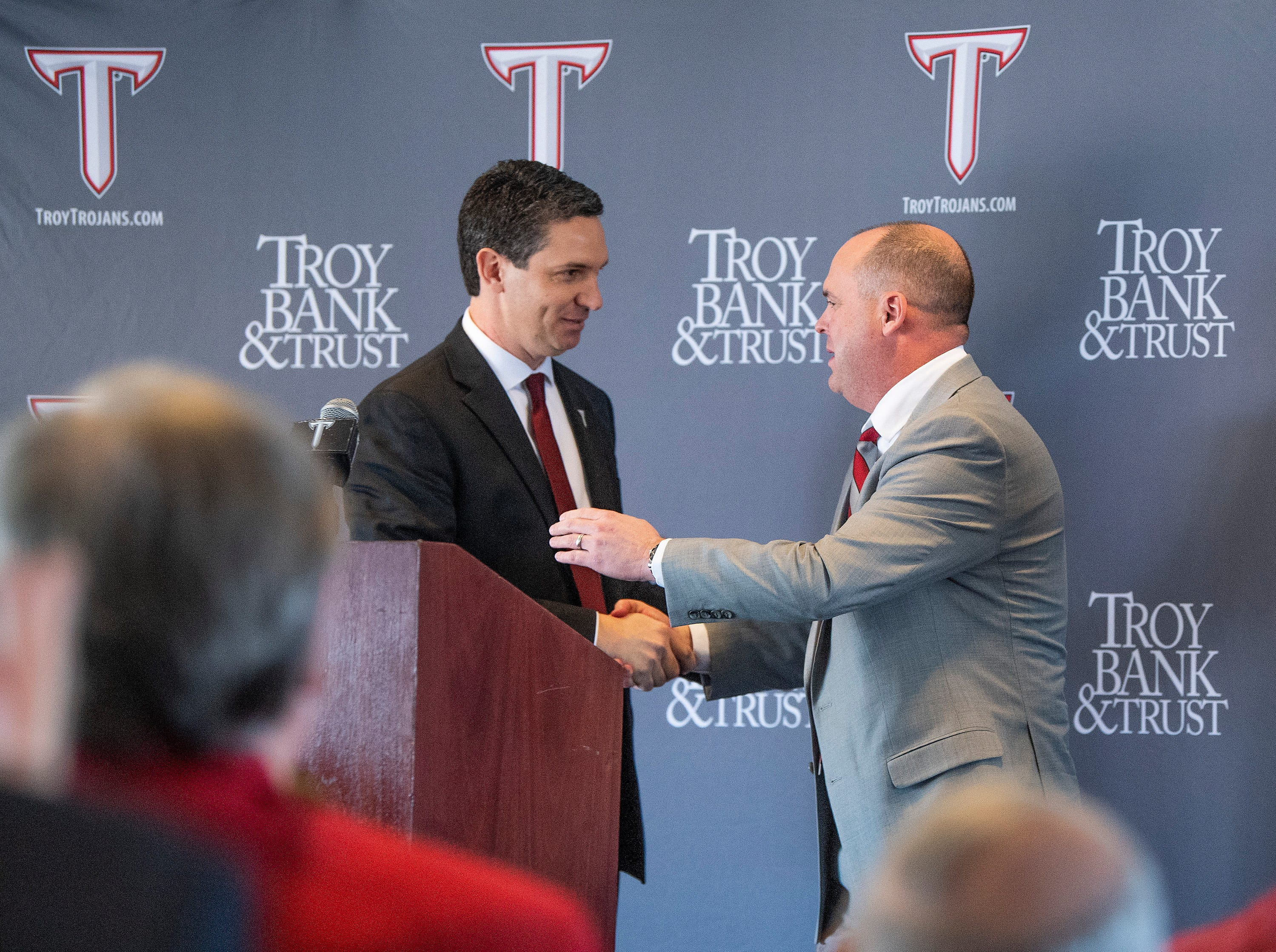 Troy University athletic Director Jeremy McClain, left, greets new Head Football Coach Chip Lindsey during his introduction on the Troy campus in Troy, Ala., on Friday January 11, 2019.