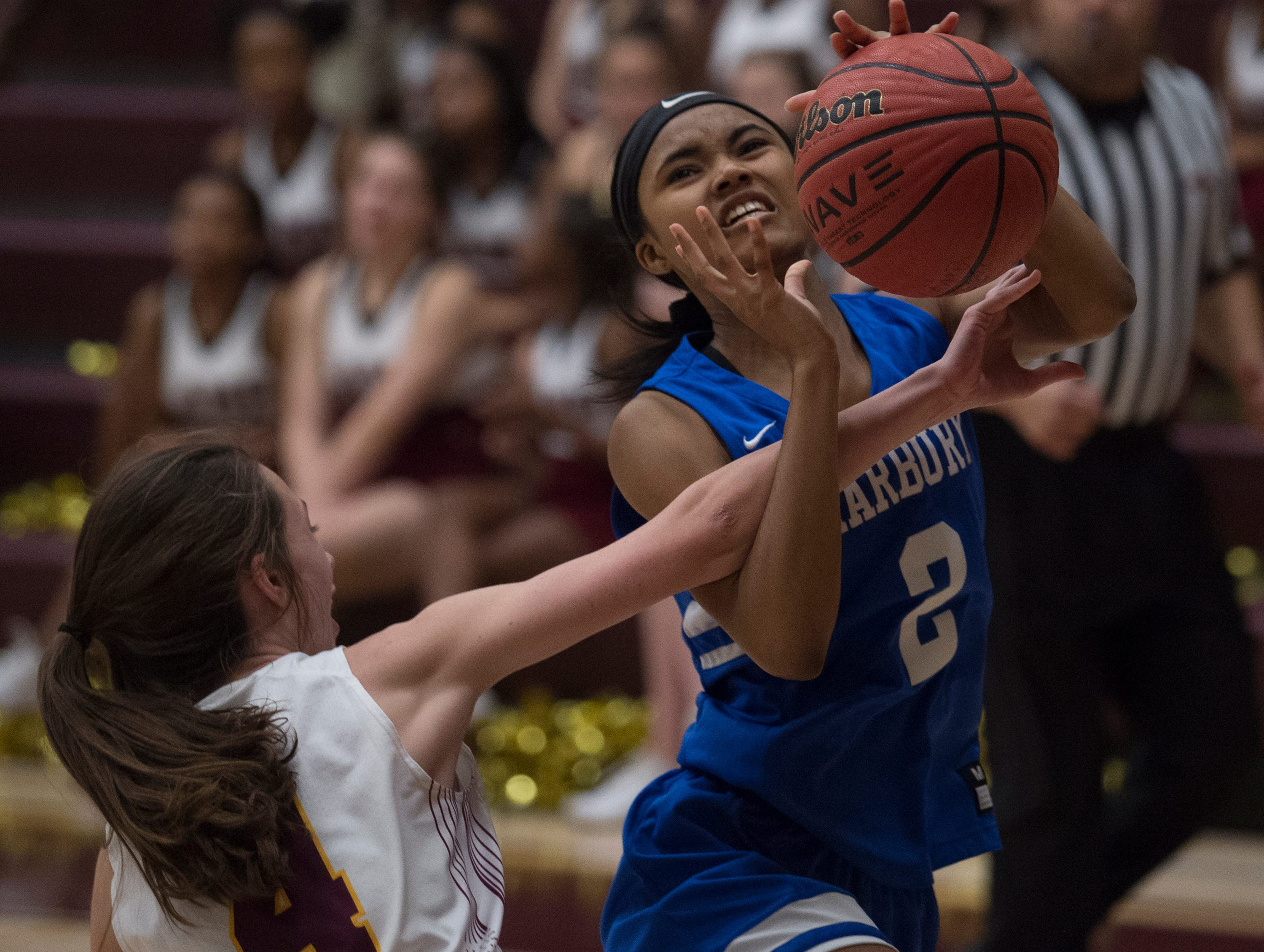 Marbury's Jazalyn Morrissette (2) is fouled by LAMP's Elizabeth Klein (4) at LAMP high school in Montgomery, Ala., on Thursday, Jan. 10, 2019.